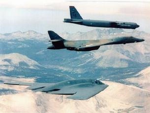 B-52 Stratofortress, B-1B Lancer, and B-2 Spirit fly in formation