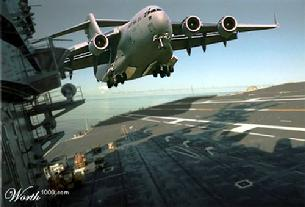 C-17 Globemaster III landing on an aircraft carrier. I'm still waiting for a picture of a C-17 being launched from a carrier.