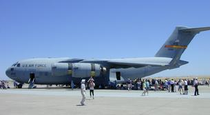 C-17 Globemaster III has a maximum weight of 585,000 pounds and is smaller than the C-5 Galaxy and is capable of landing on short airstrips