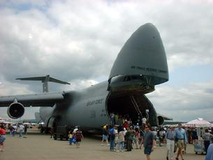 C-5 Galaxy with the doors open and landing gear lowered in the kneeling position
