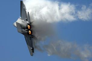 F-22 Raptor with full afterburner in a high-G turn with leading edge vortices