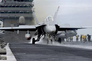 FA-18C Hornet launching from steam catapult