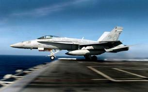 FA-18C Hornet launching off the end of the deck