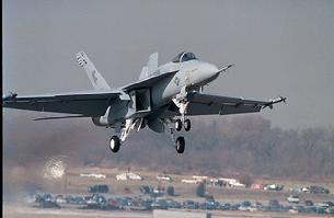 FA-18E Hornet with gear down for landing