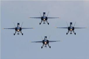 FA-18 Hornet � This Blue Angels formation is called the Dirty 4 because all flaps are down, all speed brakes are out, all tailhooks are down, and all landing gears are down.