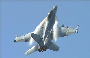 FA-18F Hornet doing a high-G pull-up. The high angle of attack causes powerful vortices to form at the leading edge extensions.