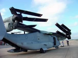 V-22 Osprey with wings, engines and propellers stowed for parking on an aircraft carrier