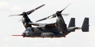 V-22 Osprey moving its engines. It can fly like an airplane with engines forward or hover like a helicopter with its engines pointing upward